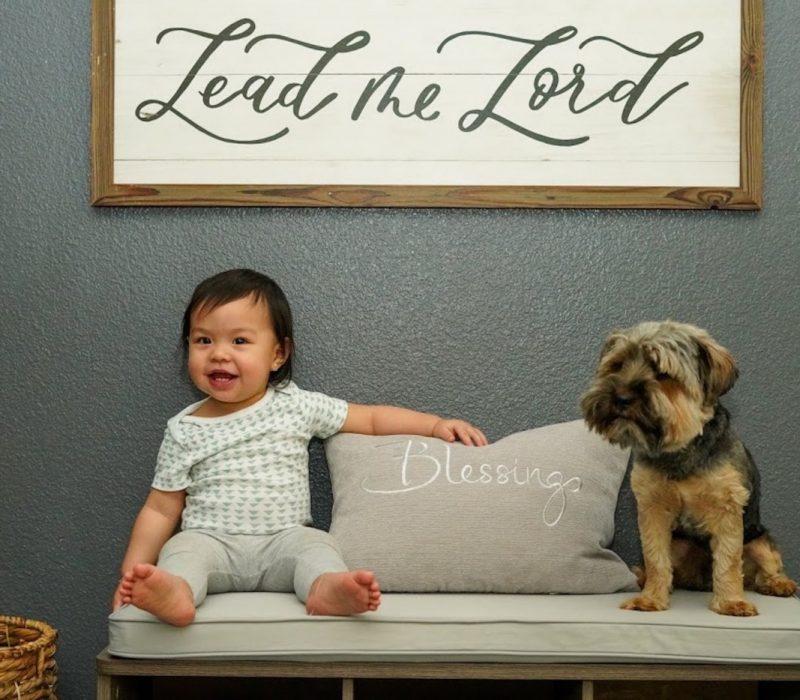 Elana Joy sitting with puppy
